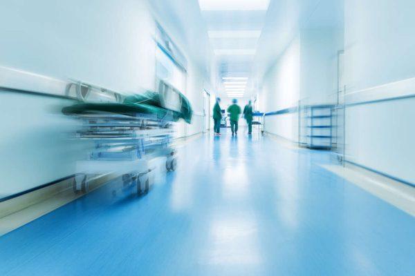 Doctors,Or,Nurses,Walking,In,Hospital,Hallway,,Blurred,Motion.