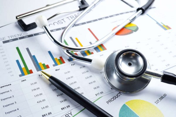 Stethoscope,,Charts,And,Graphs,Paper,,Saving,Stack,Coins,Money,,Globe