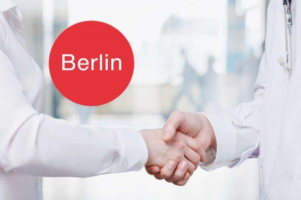 Medical,Cooperation,Concept.,Doctors,Handshake,On,Blurred,Hospital,Background.