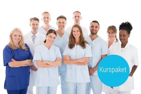 Portrait,Of,Happy,Multiethnic,Medical,Team,Standing,Against,White,Background