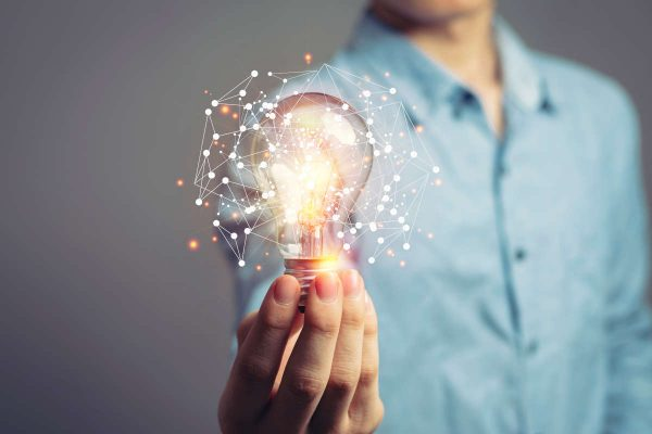 Man,Holding,Light,Bulbs,,Ideas,Of,New,Ideas,With,Innovative